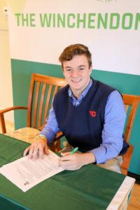 Photo of The Winchenodn School PG Nate Espelin signing his NLI