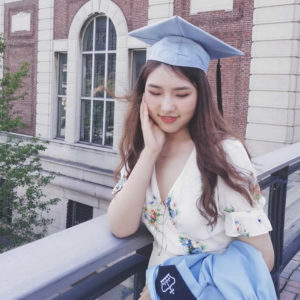 Alina with her cap and gown from graduation - Columbia University's masters program.